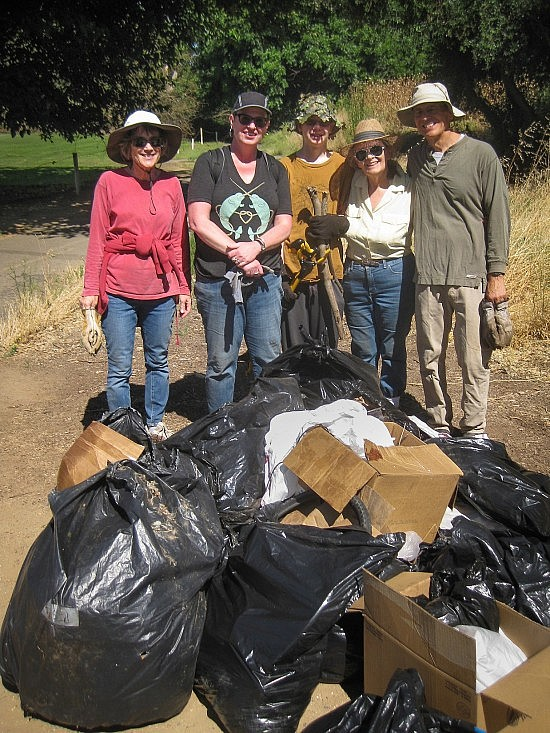 The second trash pile with intrepid collectors, from left: Barbara Gardner, Karen Hirsch, Toby Olson, Nancy Gilbert and Don Thornberry.