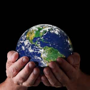 image of hands holding Earth